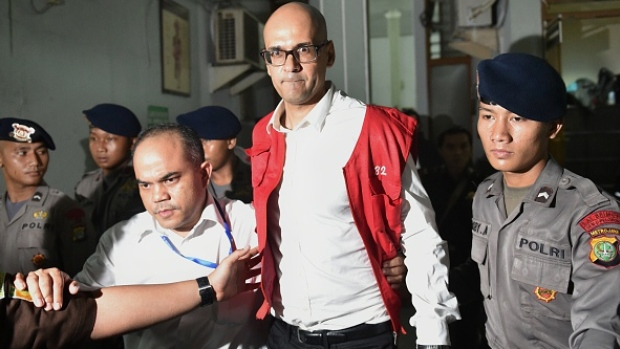 Canadian school administrator Neil Bantleman being led by police out of the courtroom after an Indonesian judge declared him guilty of abusing three young boys at the Jakarta Intercultural School, on April 2, 2015. (AFP/Getty Images)